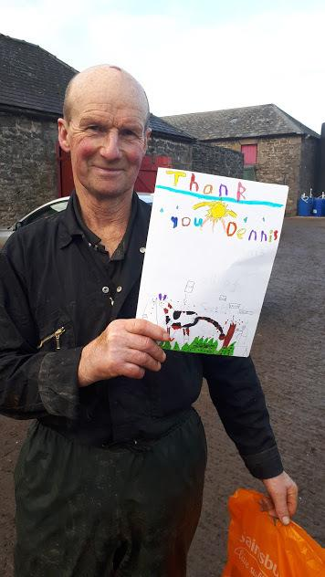 Dennis Gibb, dairy farmer and Country Trust host, of Eachwick Red House Farm, Ponteland, with his thank you card from South St Gateshead Primary School.