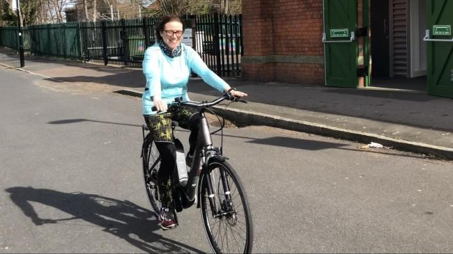 NHS worker Fiona Toland-Mitchell, from The Newcastle Upon Tyne Hospitals NHS Foundation Trust with her Ride Electric bike.