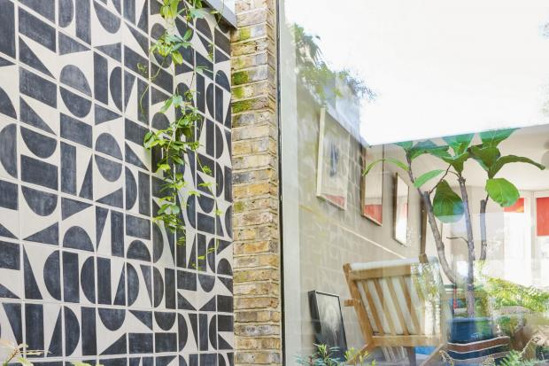 Undated Handout Photo of a contemporary Mediterranean garden using graphic tiles. See PA Feature GARDENING Small. Picture credit should read: Jason Ingram/Mitchell Beazley/PA. WARNING: This picture must only be used to accompany PA Feature GARDENING Small