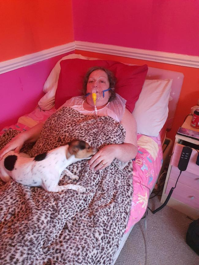 Janice Keen, recovering at home in Acomb with her family dog, continues to use an oxygen mask.