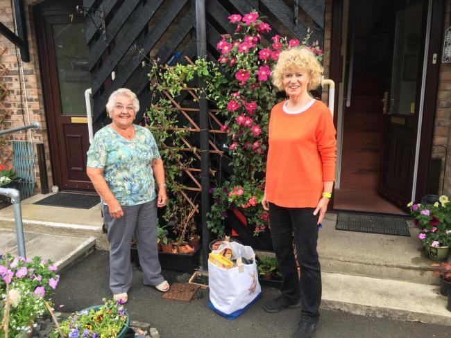 Hexham Community Together volunteer Catriona Mulligan delivering shopping to Hexham resident Thelma Davidson.