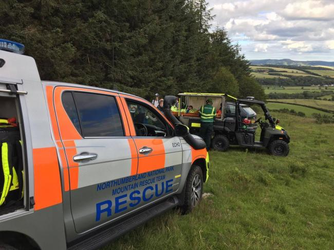 Mountain rescue teams evacuate a mountain biker who had suffered serious injuries.