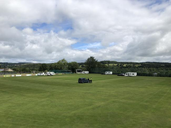 Police at the scene as cars and caravans are parked on the Prior's Flat pitch. Photo: Tynedale CC