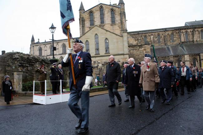 The Annual Service of Remembrance at The War Memorial Beaumont Street Hexham. Nick Short lead the vertarans with the standard up Beaumont Street. D460951 0010469H002.jpg.