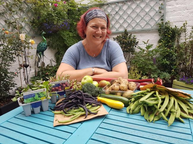 Ginnie O'Farell with homegrown produce for the foodbank