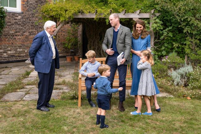 The Duke and Duchess of Cambridge, Prince George (seated), Princess Charlotte and Prince Louis with Sir David Attenborough in the gardens of Kensington Palace after the Duke and Sir David attended an outdoor screening of Sir David's upcoming feature f