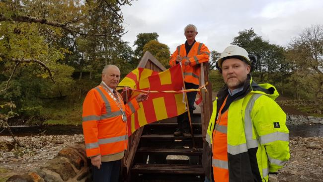 oger Morris (with flag), Cllr Ian Hutchinson and Scott Wharton, NCC Highways Project Manager