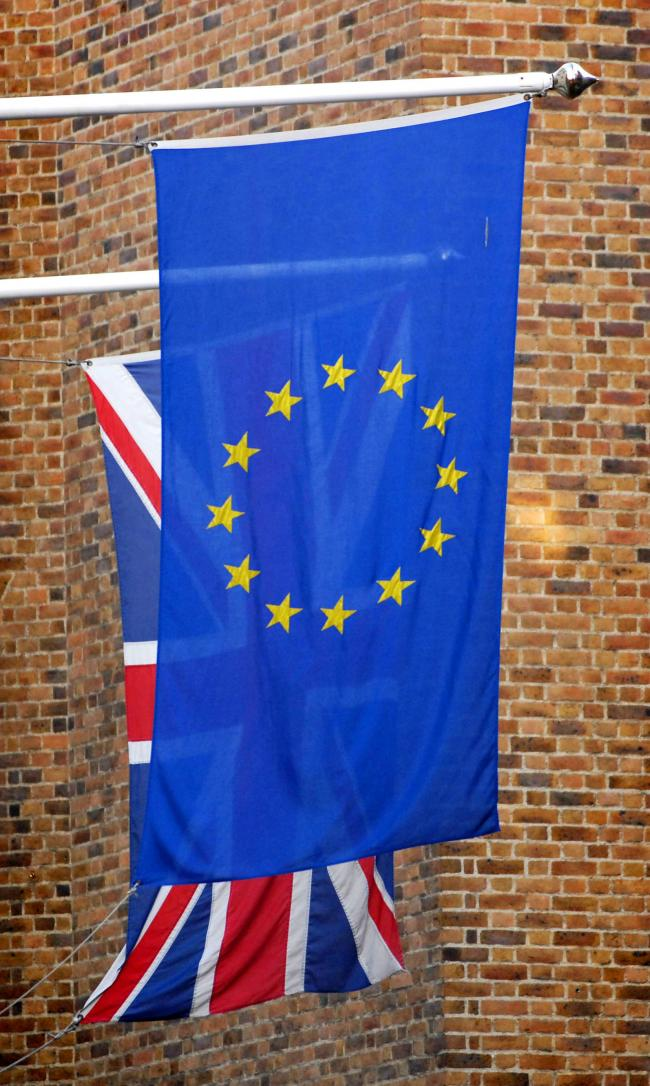The Union Jack pictured behind the European Union flag in London..