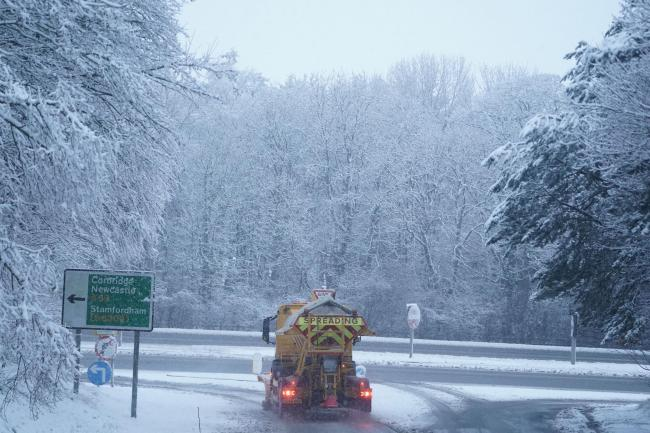 Gritter on snowy road
