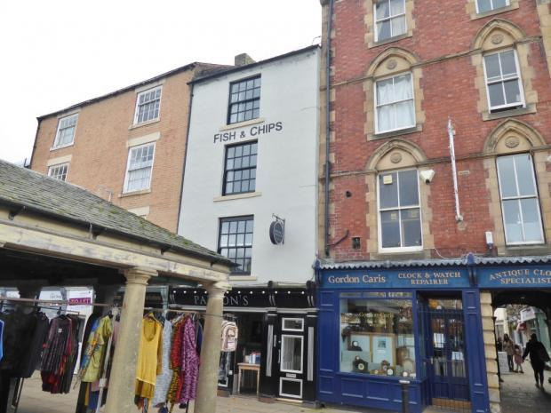 Hexham Courant: The one-bedroom flat looks over Market Place in Hexham. Photo: Zoopla