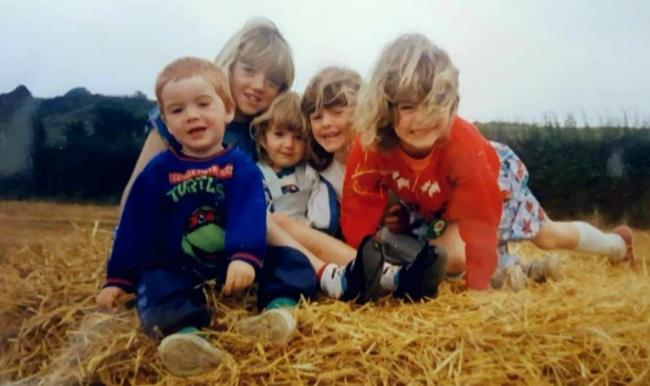 Happy family memories: Kelvin, Shelley, Sonia, Angie and Glynis Murray-Hill pictured in the early 90's.