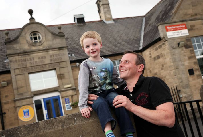 Oliver Macklam (5) with his dad David, at Broomley First School in Stocksfield. Photo: Paul Norris.