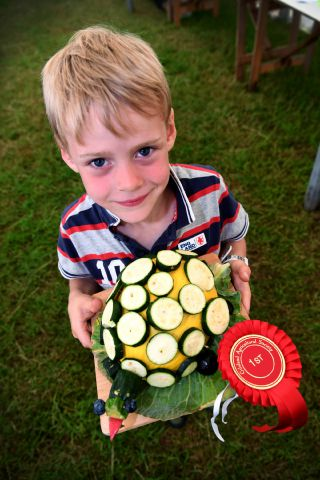 Gilsland Show. Matthew Ritson with his winning vegetable animal at Gilsland Show.