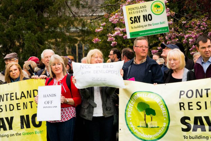 Residents gathering in Ponteland to protest against plans to build on green belt land.
