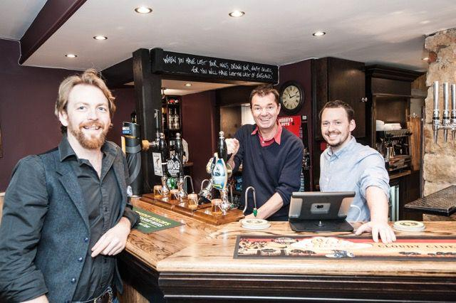 Guy Opperman MP takes a turn behind the bar at The Dyvels Inn. Left to right: Chris Baxter, publican, Guy Opperman MP and Richard Baxter, partner in the pub.