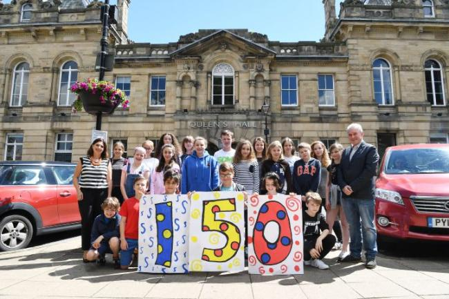The Queen's Hall Arts charity has just been awarded £150,000 from Arts Council England coinciding with their 150th anniversary year. Pictured are Sharon West, development manager and Geof Keys, artistic director, with youngsters from the summer school. P