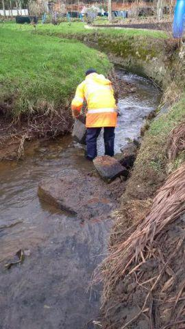 A specialist team has cleared away silt clogging up a flood channel in Wark.