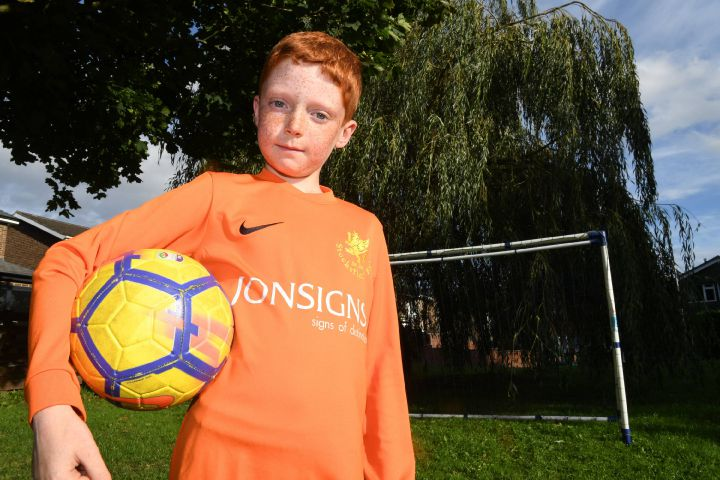 Young footballer Marcus Wells who suffers from colourblindness. Photo: KATE BUCKINGHAM.