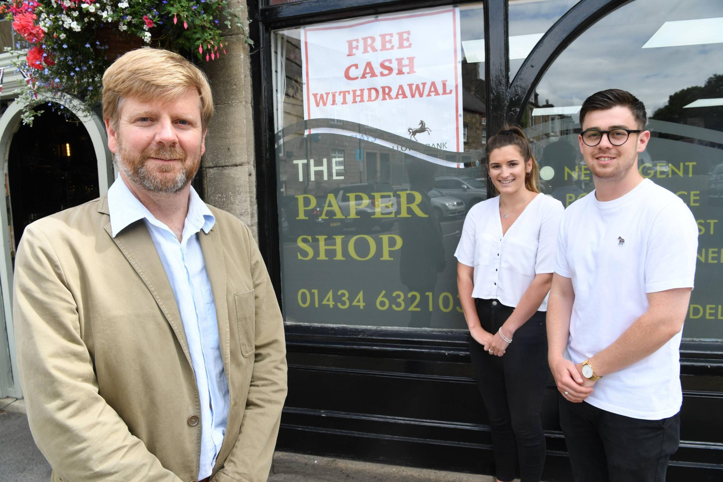 County Councillor Nick Oliver,with Grace Cuthbertson and Jack Garrett, of Corbridge Post Office.