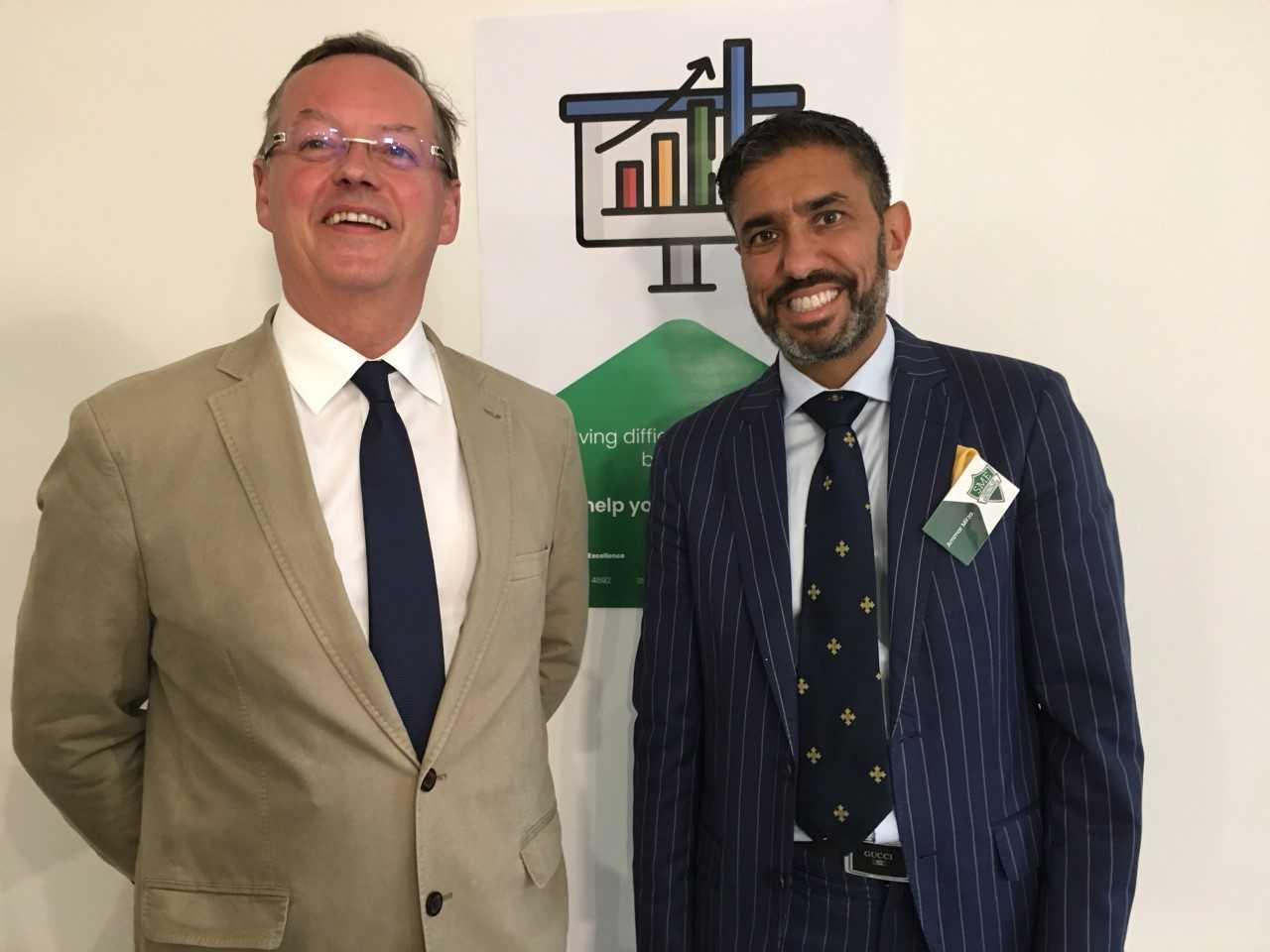 Ammar Mirza (right), who has set up an SME Centre of Excellence in Ponteland, pictured with Coun. Peter Jackson.
