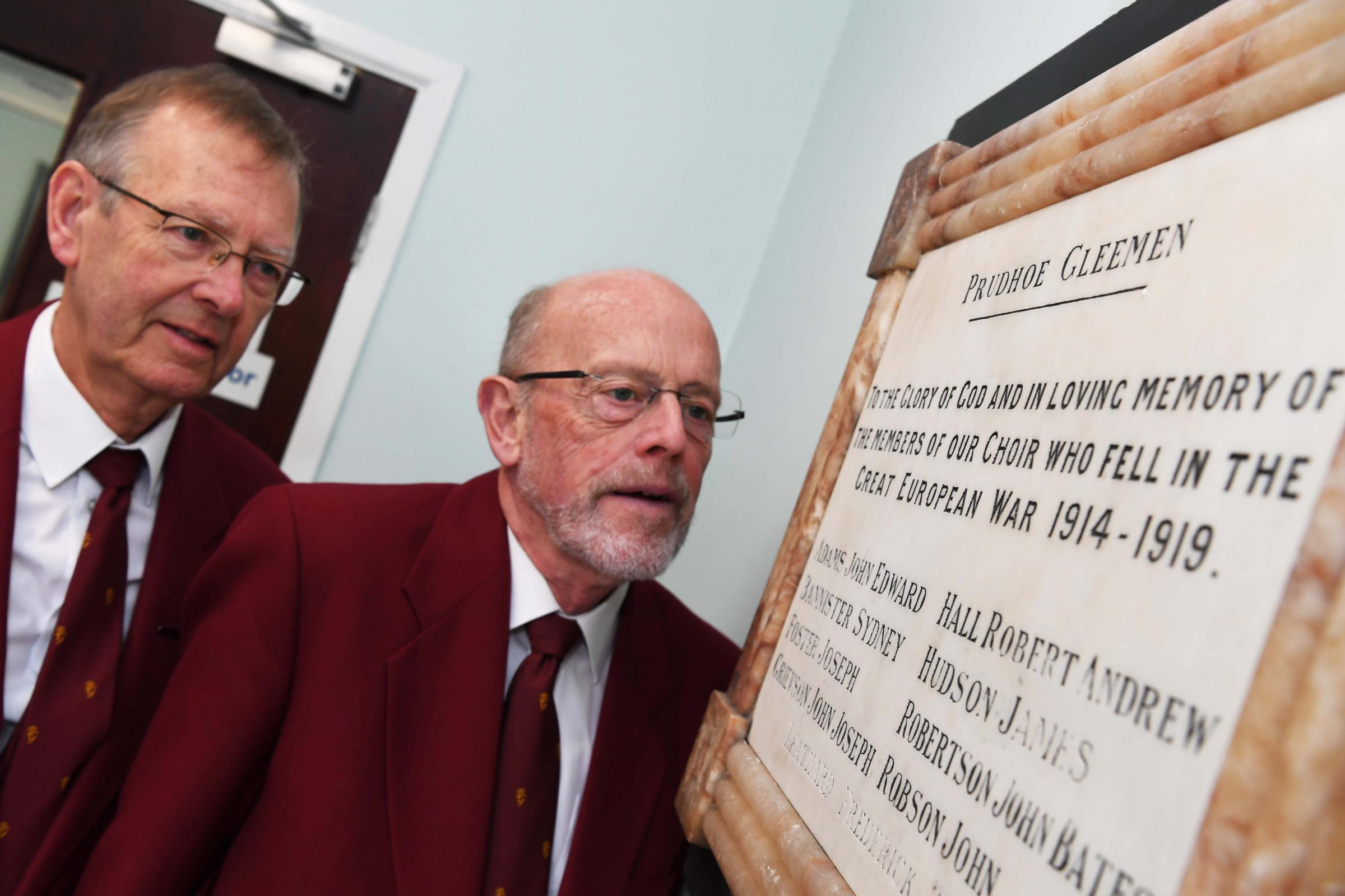 Prudhoe Gleemen Neville Fairbairn and John Clark next to the memorial plaque in Prudhoe Methodist Church.          Photo: HX441854