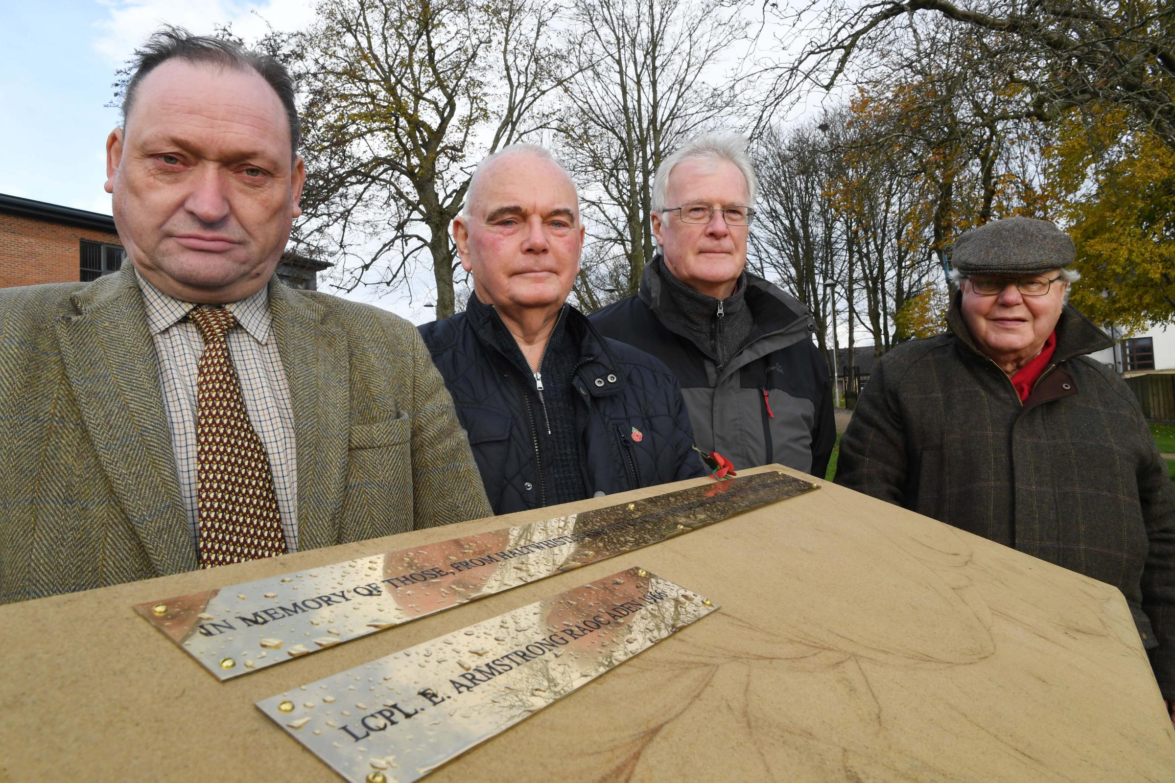 Town councillors Alan Sharp, Michael Ridley, John Elliott and Graham Ridley next to the new memorial stone at a Haltwhistle war memorial. Photo: HX471886. KATE BUCKINGHAM.