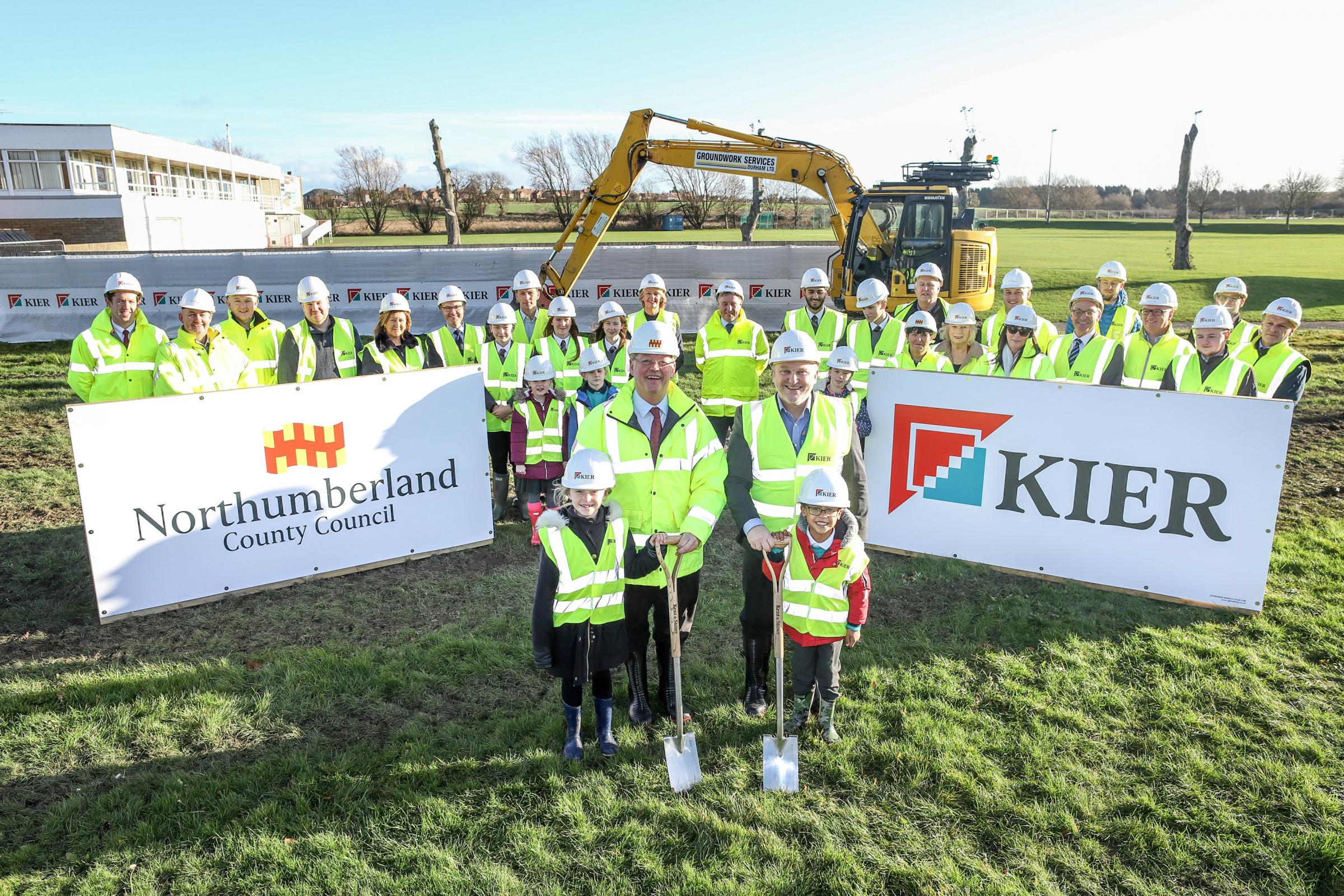 Coun. Peter Jackson, leader, and Coun. Wayne Daley, deputy leader and cabinet member for children's services (left to right at front), cutting the first turf at the Ponteland Schools development - along with students and headteachers from Ponteland