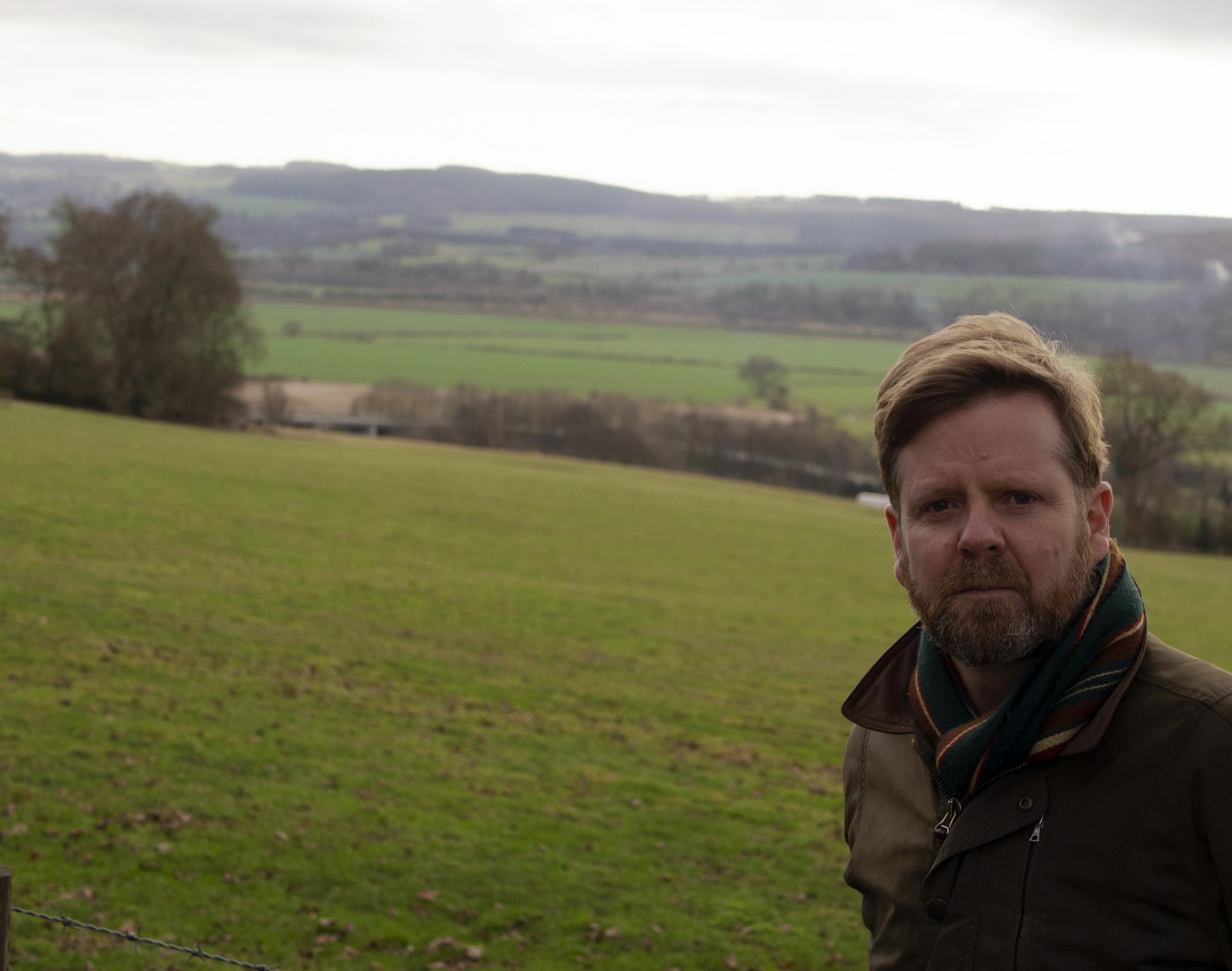 Corbridge's Northumberland county councillor Nick Oliver overlooking the site of a planned sand and stone quarry at Anick Grange Haugh.