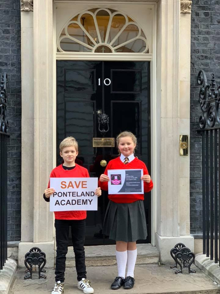 Daniel and darcey powers delivering the petition to Number 10 Downing Street in london