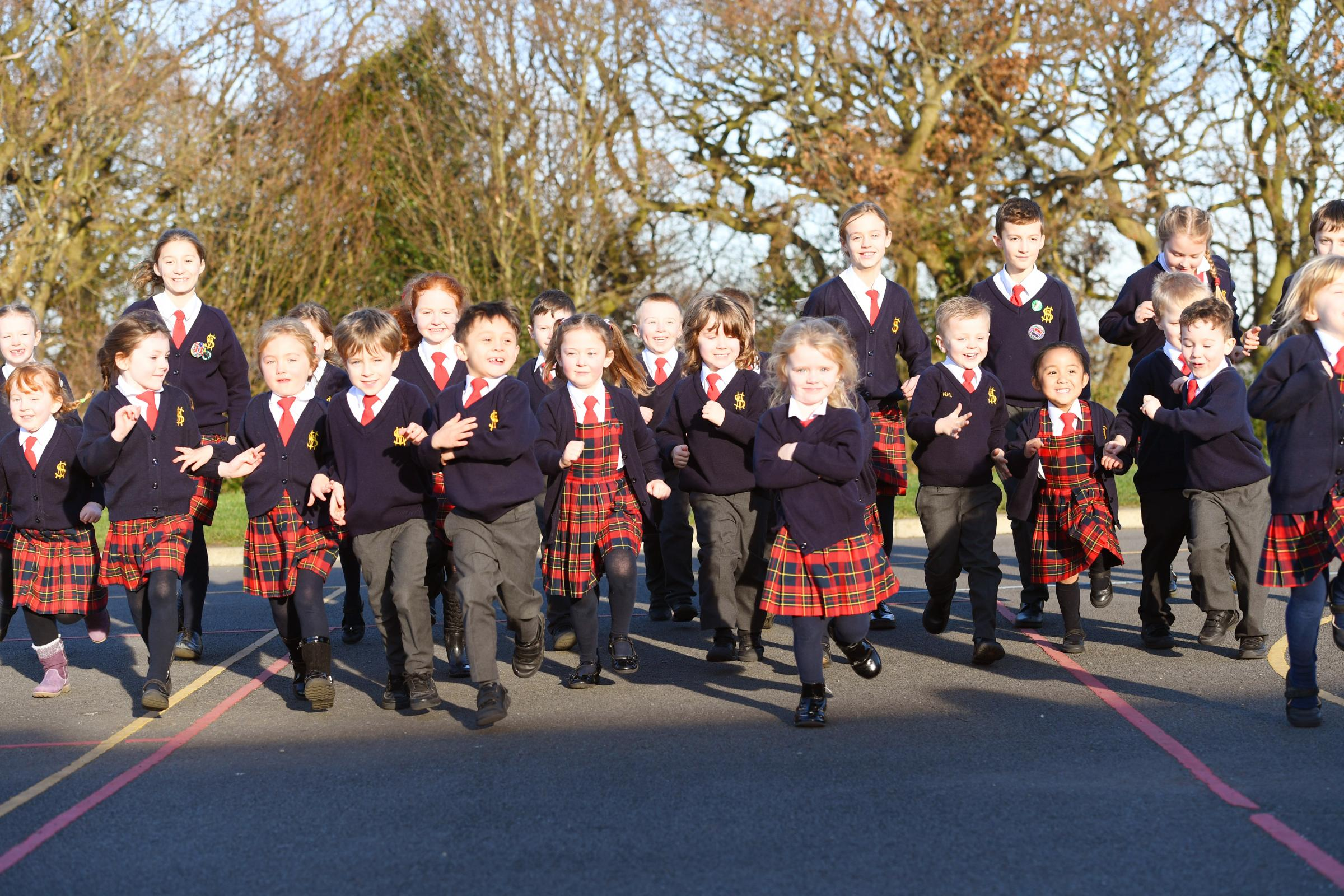 Students from St Matthew's Primary School take part in the Daily Mile sessions.    	      Photo: KATE BUCKINGHAM