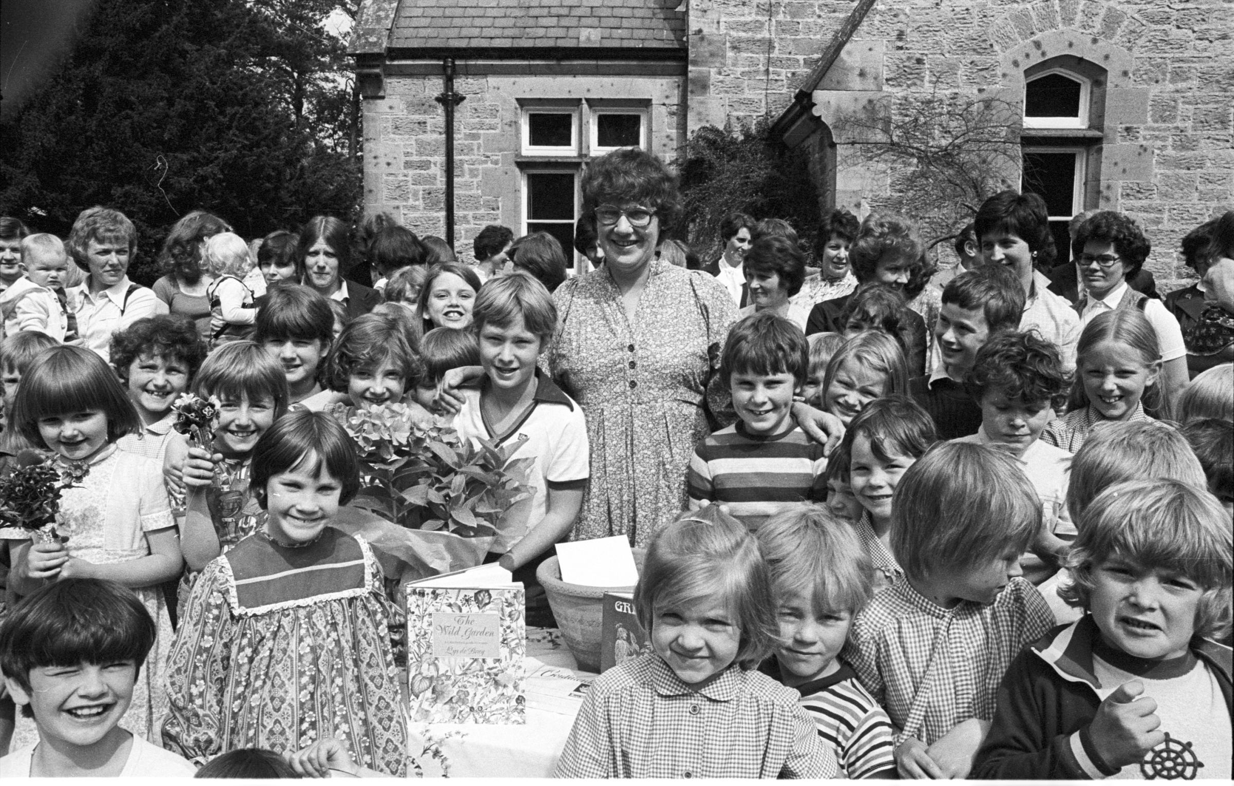 Parents, pupils, and staff at Belsay First School on July 25, 1980. Do you recognise any of the faces?
