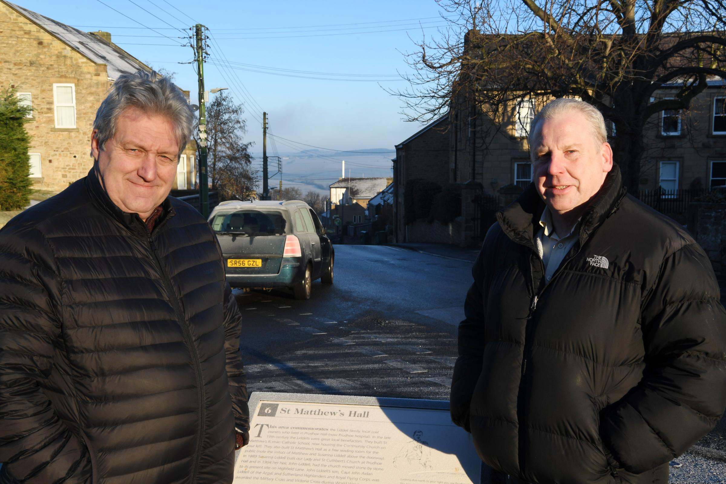 Coun. Ken Stow (left) and Coun. Gordon Stewart at the junction where a crossing is to installed in Prudhoe. 									  Photo: HX041948