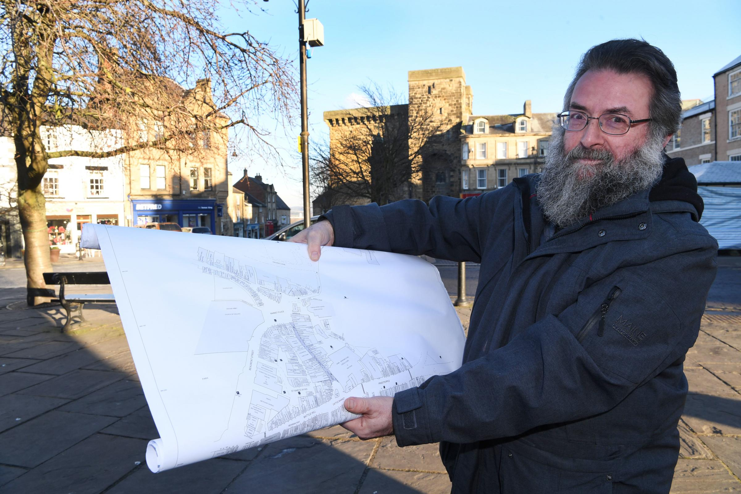 Mark Benjamin with one of the old street plans of Hexham. 												      Photo: HX061924
