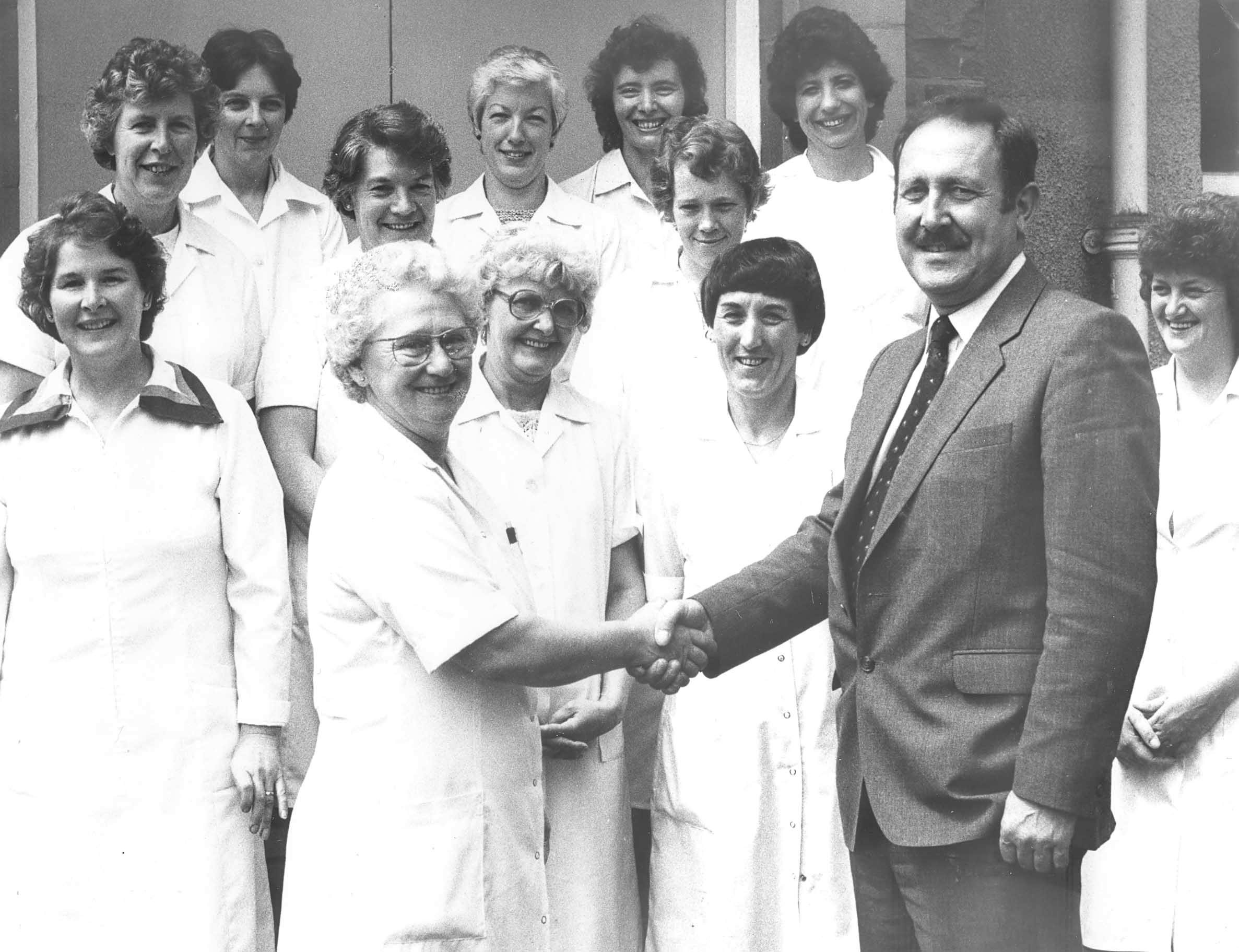 Retirement of cook at Prudhoe High School July 19th 1985. Mrs Betty Dobson bids farewell to headteacher Neil Davis. 50065142H001.jpg