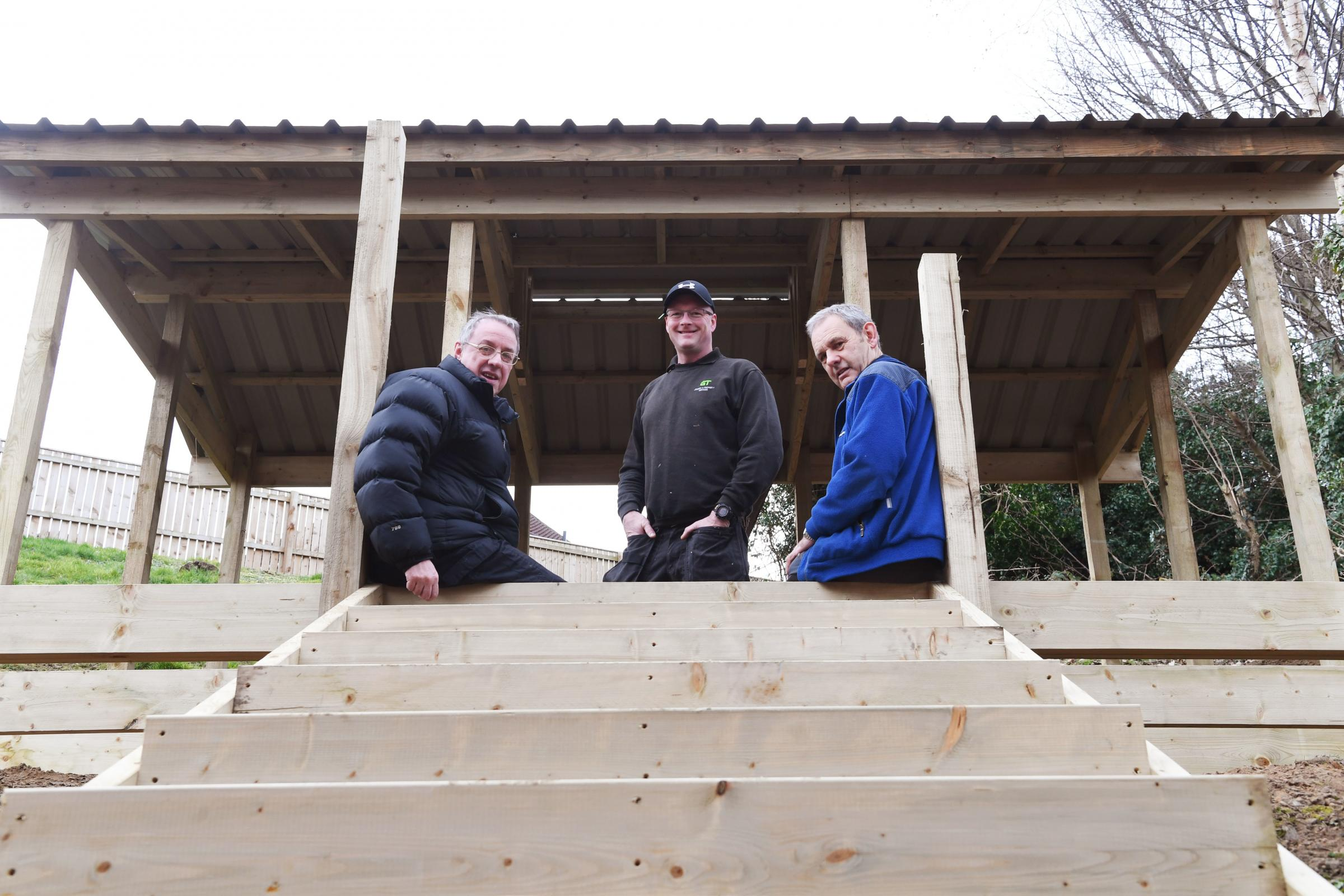 From the left, David Hefferin and David Newman from Hexham Scouts with Glen Todd who is building the memorial fire shelter in memory of Jack Cawood. 					Photo: HX081967