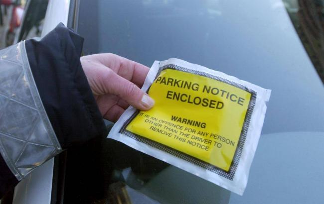 A new book may help drivers avoid unfair parking tickets