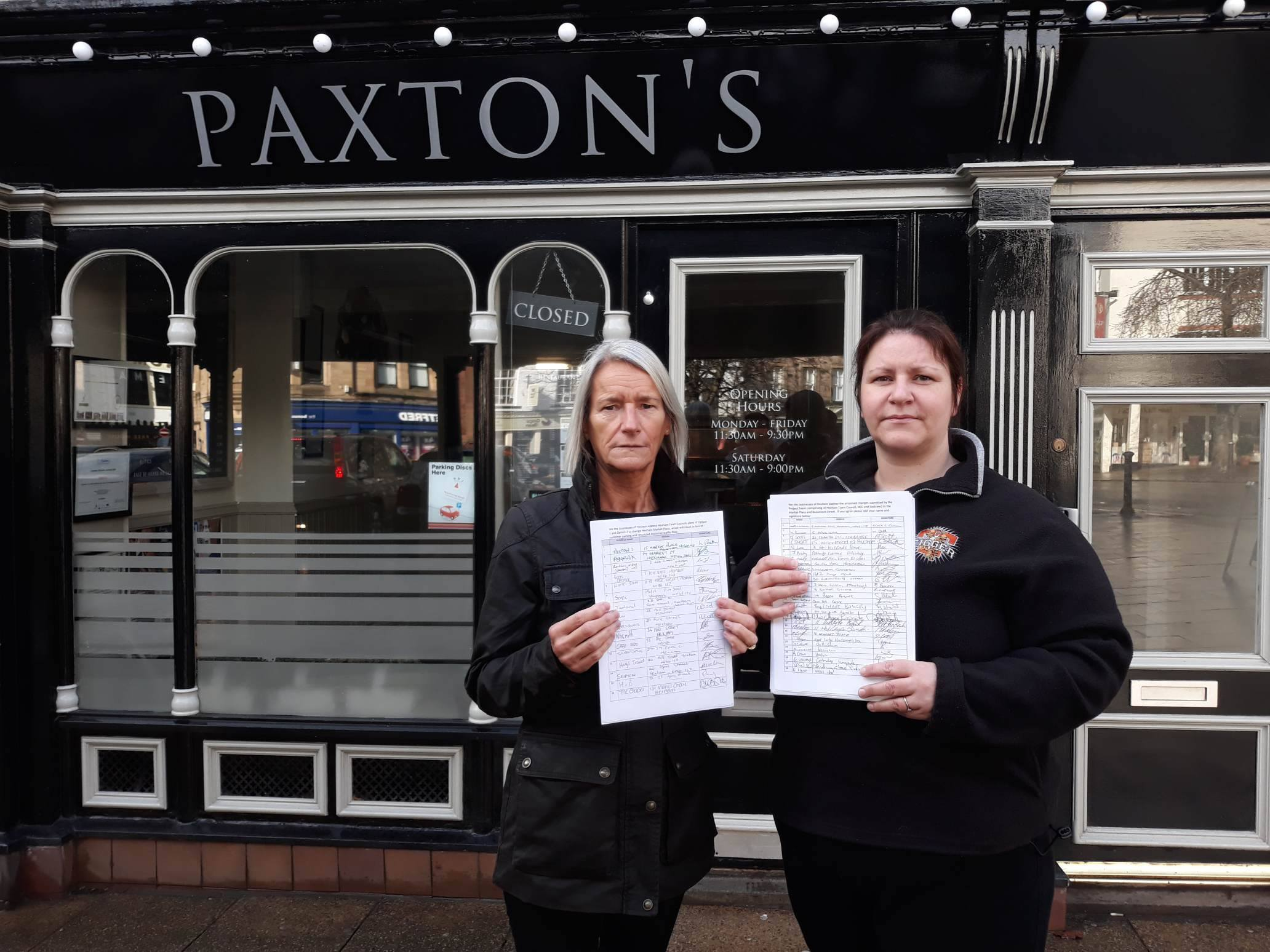 Owners of Paxton's fish and chips Lorna and Natalie Paxton with petitions against proposals for Hexham Market Place.