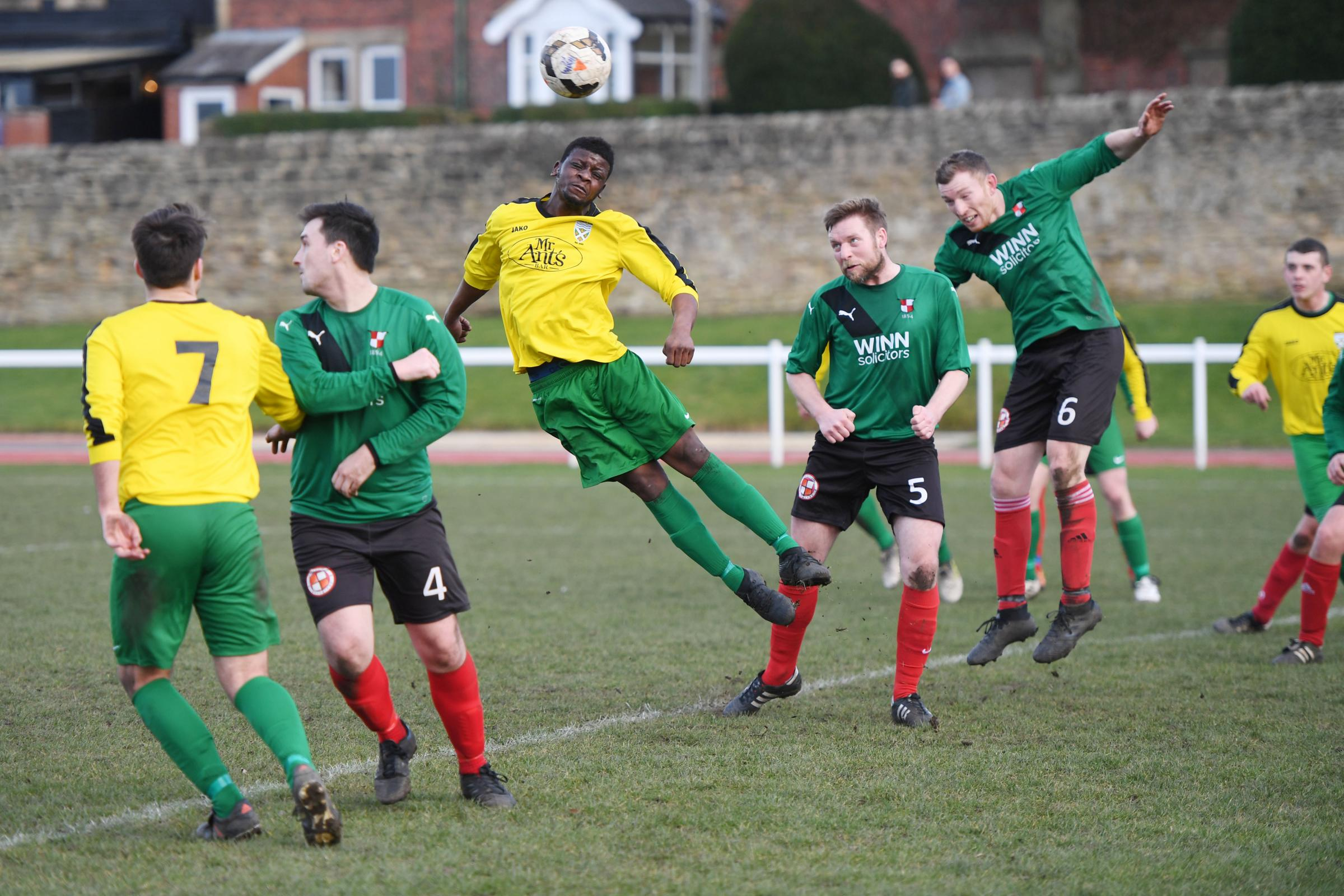 Dylan Mabunu (centre) scored two goals for Hexham in their 3-2 victory over Seaton Burn. Photo: KATE BUCKINGHAM