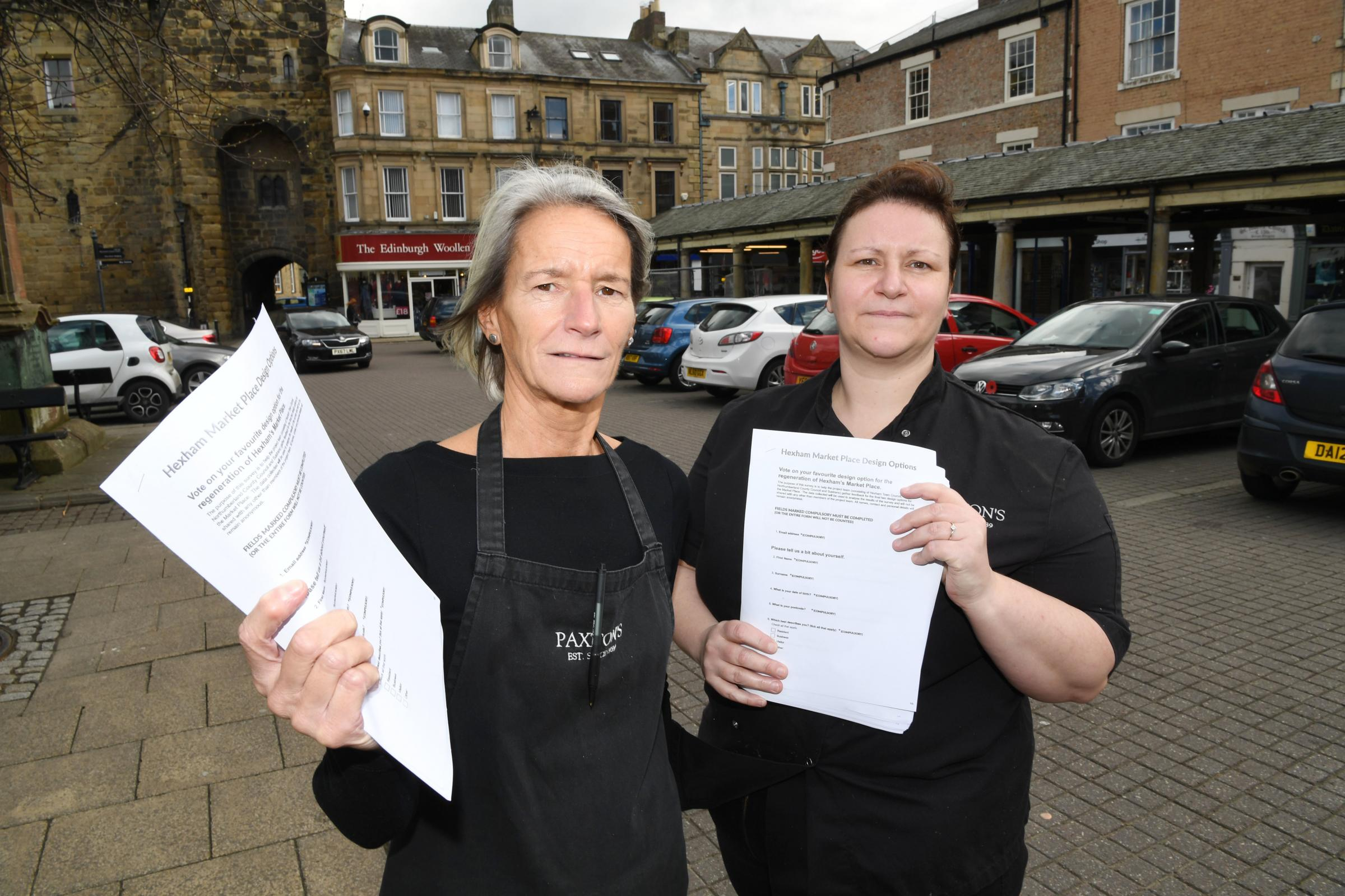 Lorna and Natalie Paxton with the petitions against the pedestrianisation of Hexham Market Place.    Photo: HX111968