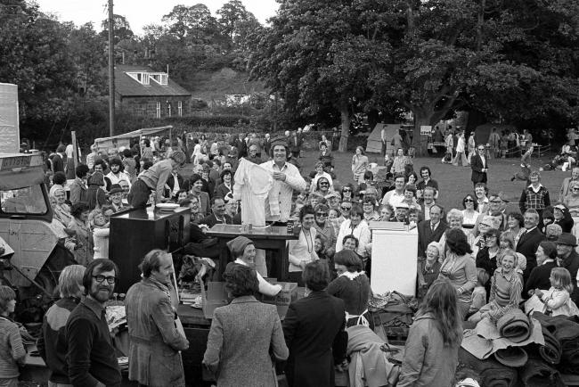 Residents and visitors experience all the fun of the fair as the auction gets into full swing at Ovingham Goose Fair, on Saturday, June 19, 1976.