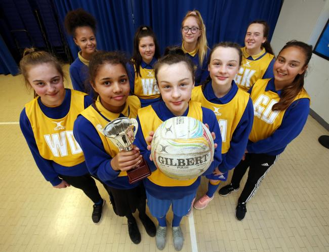 Highfield Middle School's U13 netball team with the Northumberland county trophy after their success at the grand finals. Photo: PAUL NORRIS