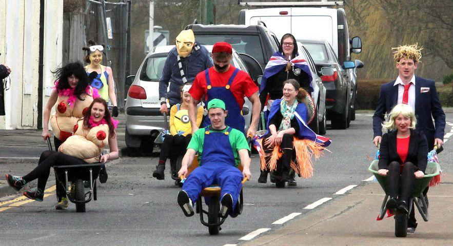 The annual Easter Monday wheelbarrow race gets underway in Haydon Bridge in 2016. Photo: Tom Buist.