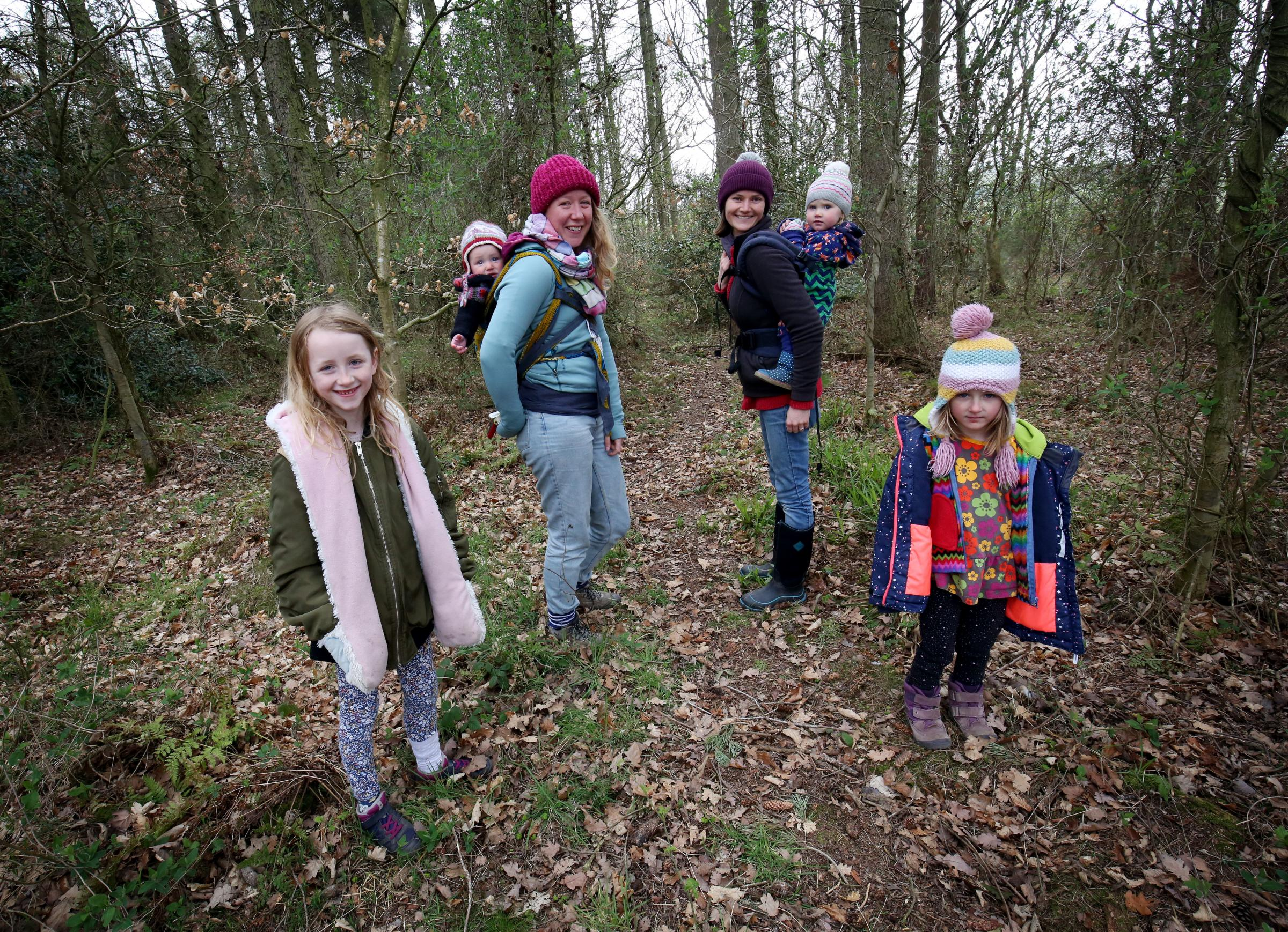 Stomping Grounds Forest School hopes to take over Prudhoe woodland. Pictured at the site are Nina Coburn (8) Sophie Watkinson with baby Elwood, Jessica Lloyd with 18-month-old Juniper and Annie Coburn (5).  								          Photo: PAUL NORRIS