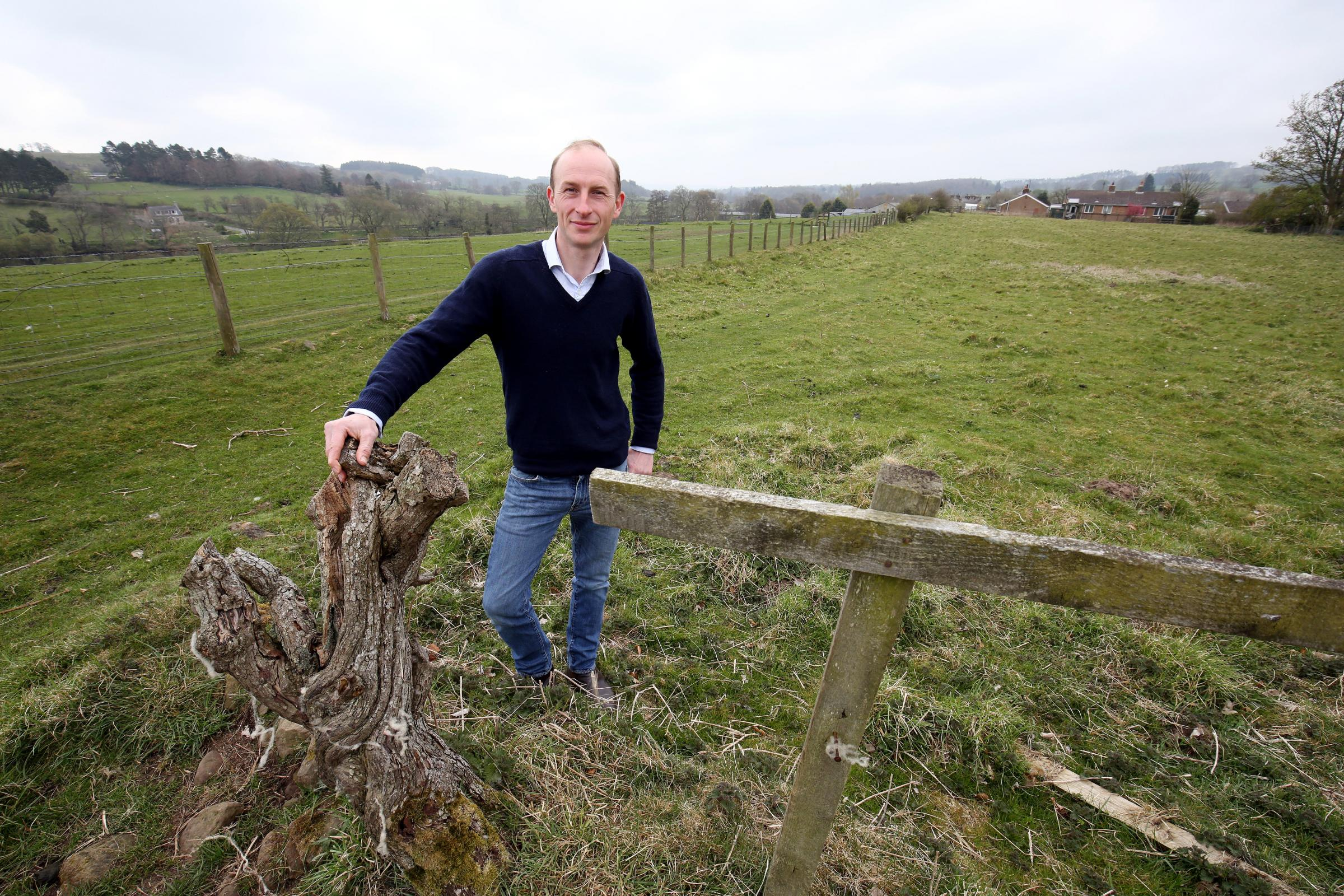 James Thompson on the land where he wants to build homes in Wark. 		          Photo: PAUL NORRIS