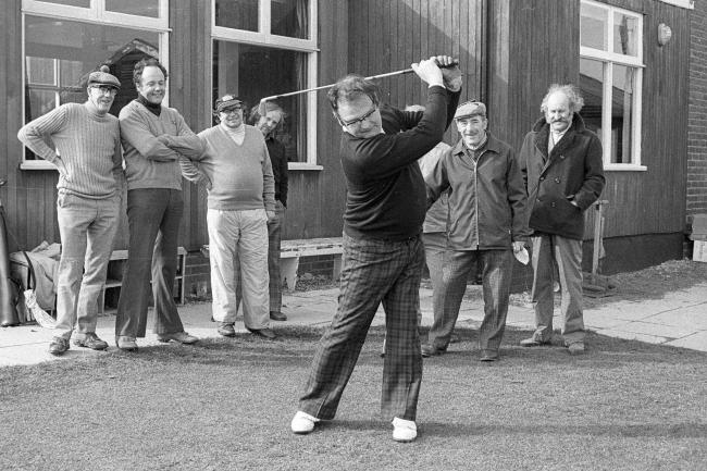 Making sure the golfing season starts with a good swing is the new captain of Stocksfield Golf Club, Mr Colin Kirkby, who observed the traditional 'driving in' day on Saturday, March 27. He is being observed by some of the club members and guests.