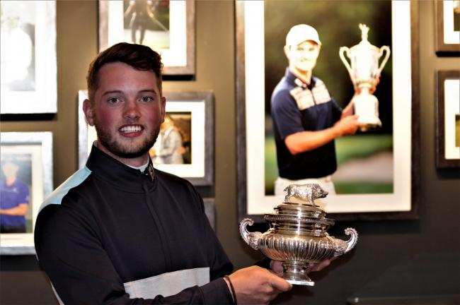 Hexham golfer Matty Lamb with the Hampshire Hog trophy, and an image of previous winner Justin Rose. Photo: MARK SANDOM