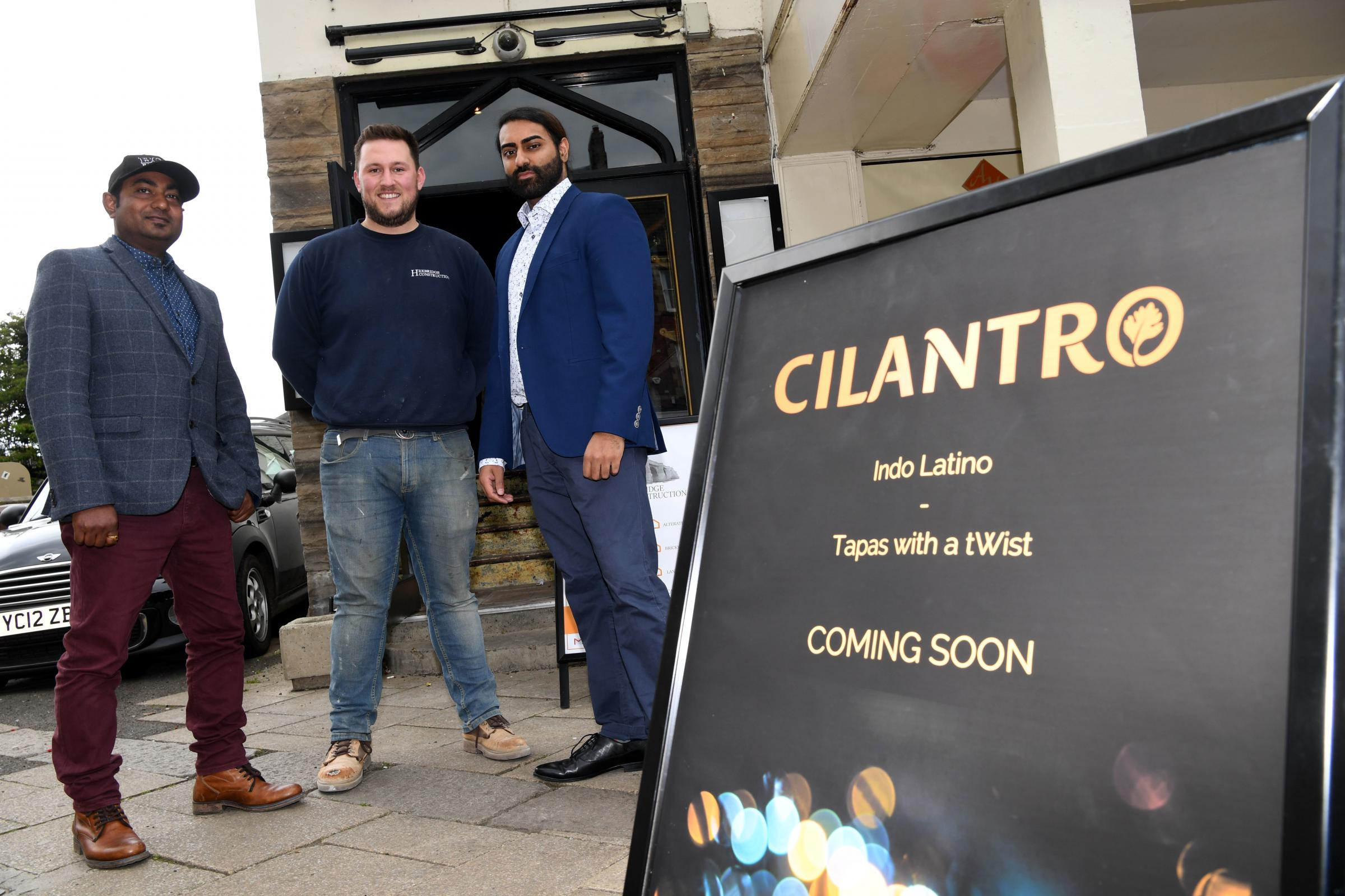 Cilantro head chef Atindra Naskar (left) and owner Nabs Aziz (right) flank Hexbridge Construction owner Jordan Stothard at the former Valley restaurant which is being transformed into a tapas bar.