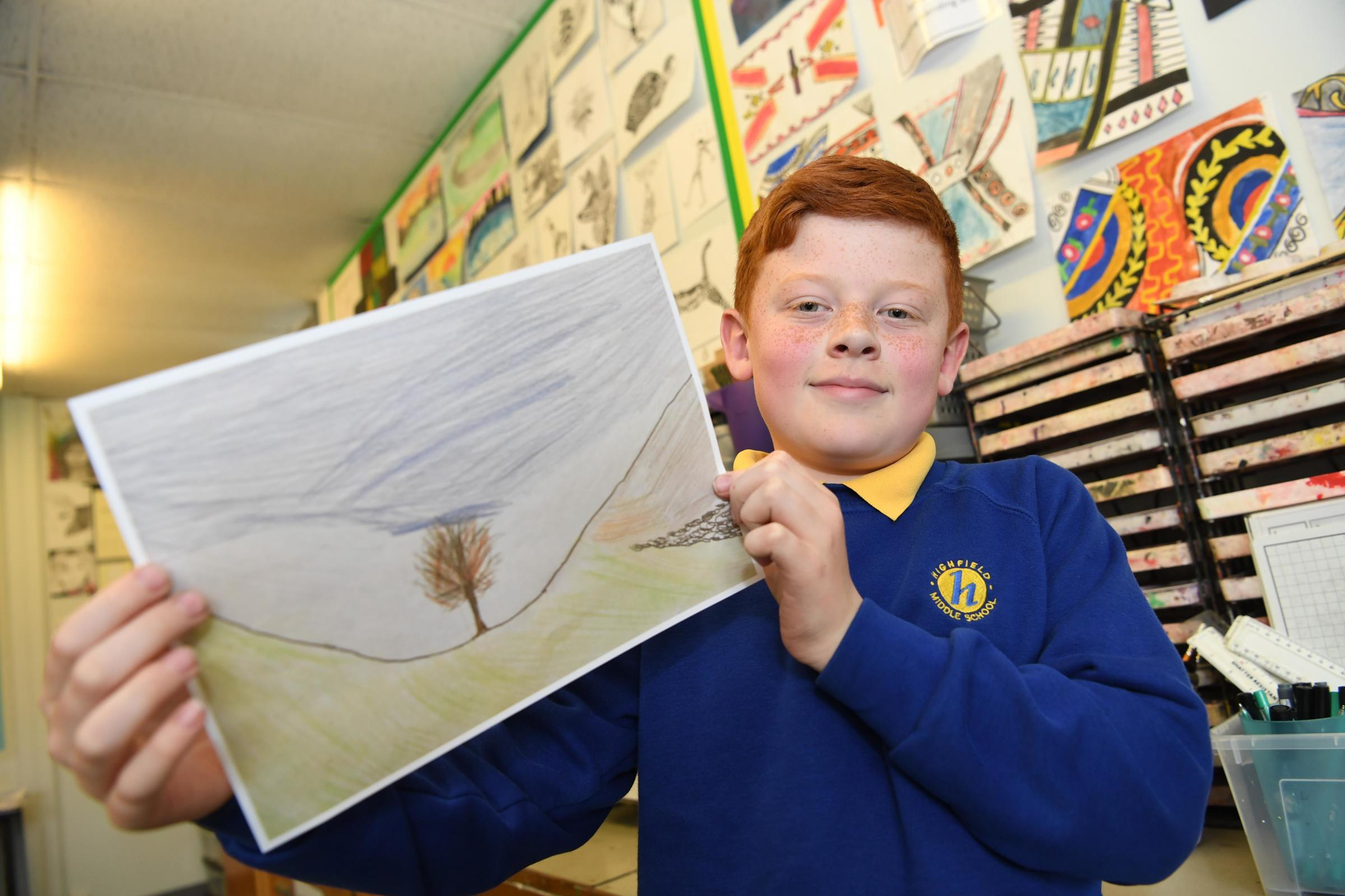 Oliver Stirk from Highfield Middle School in Prudhoe with his design for the Northumberland Day stamp. Photo: HX191949