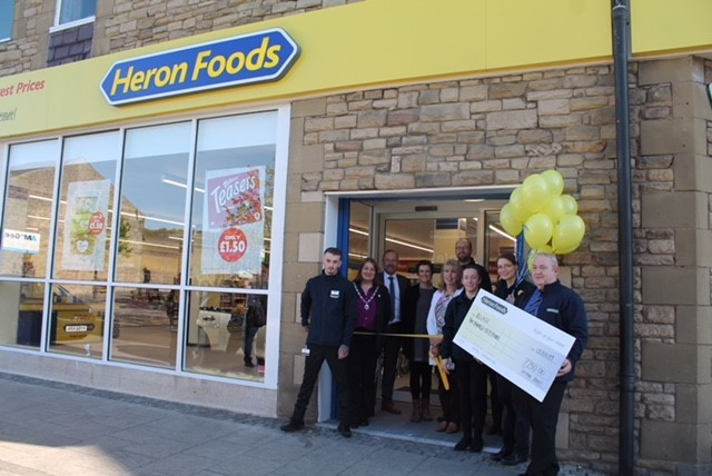 Staff from Relate charity shop and Heron Foods at the official opening of the discount food store in Prudhoe.