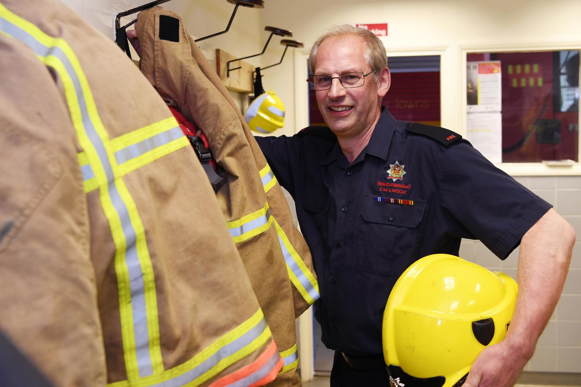 Retained firefighter Neville Pringle hangs up his tunic for the last time at Allendale Fire Station, after 39 years. 		Photo: HX201937